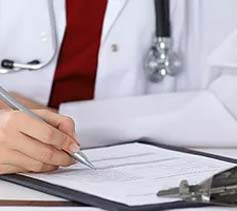 A skin specialist taking notes on family history of skin cancer for treating skin cancer