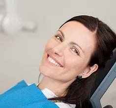 A skin cancer patient smiling during after the skin cancer diagnosis